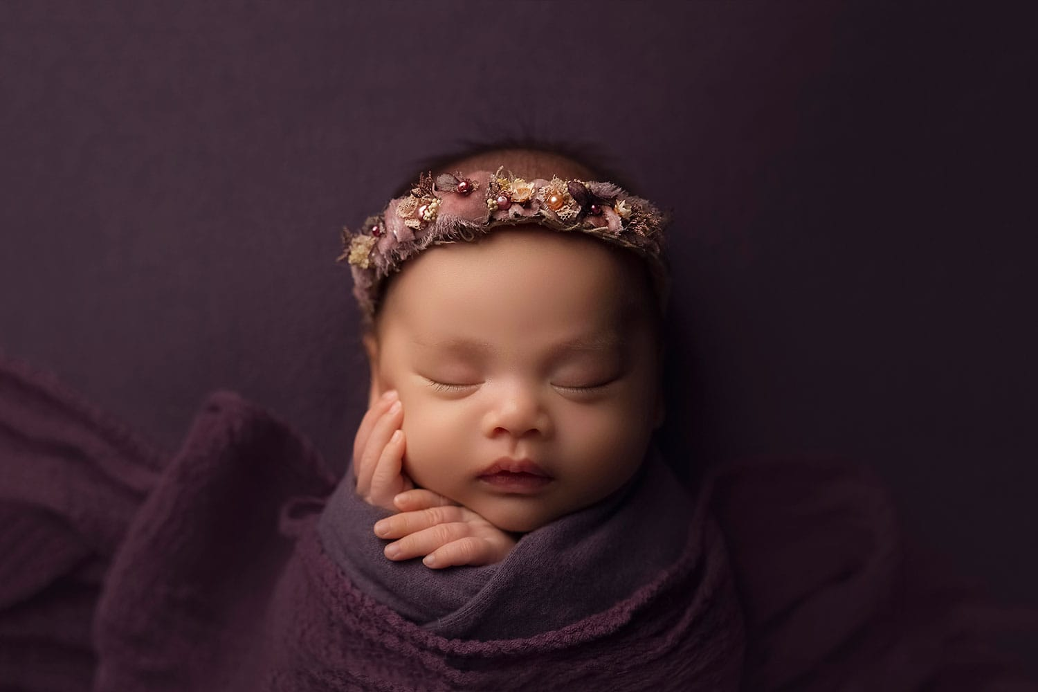 newborn baby girl in purple halo and wrap by Annie Whitaker Photography