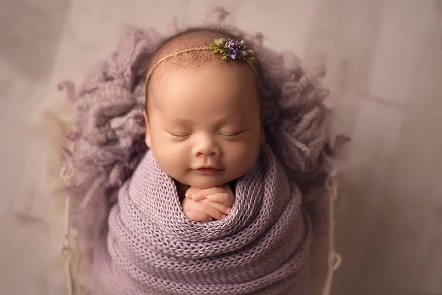 stunning newborn girl in purple by Annie Whitaker Photography
