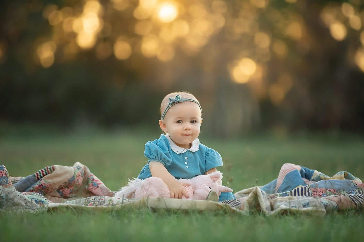 Baby girl at sunset by Annie Whitaker Photography