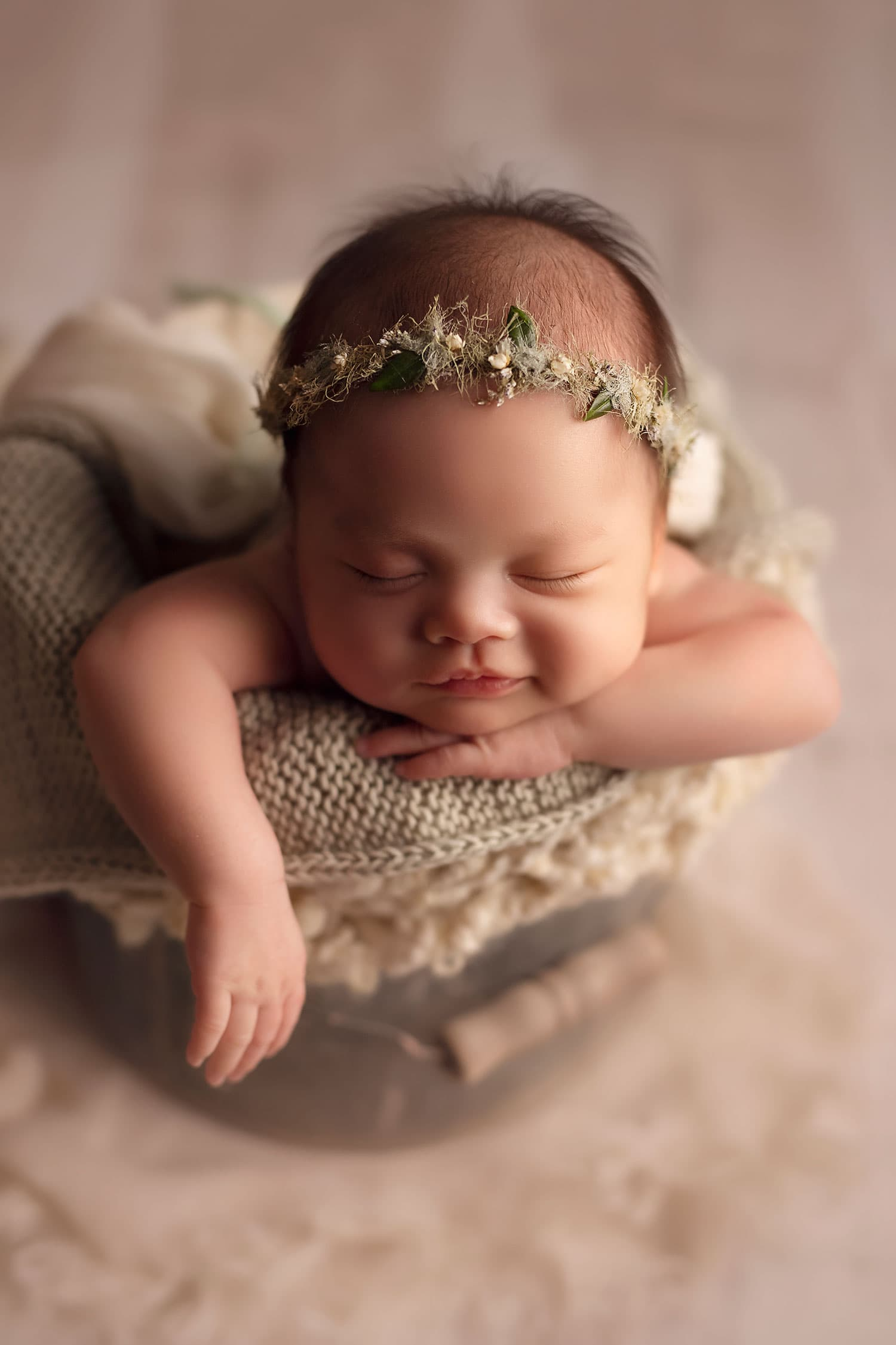 smiling newborn in bucket pose by Annie Whitaker Photogrpahy