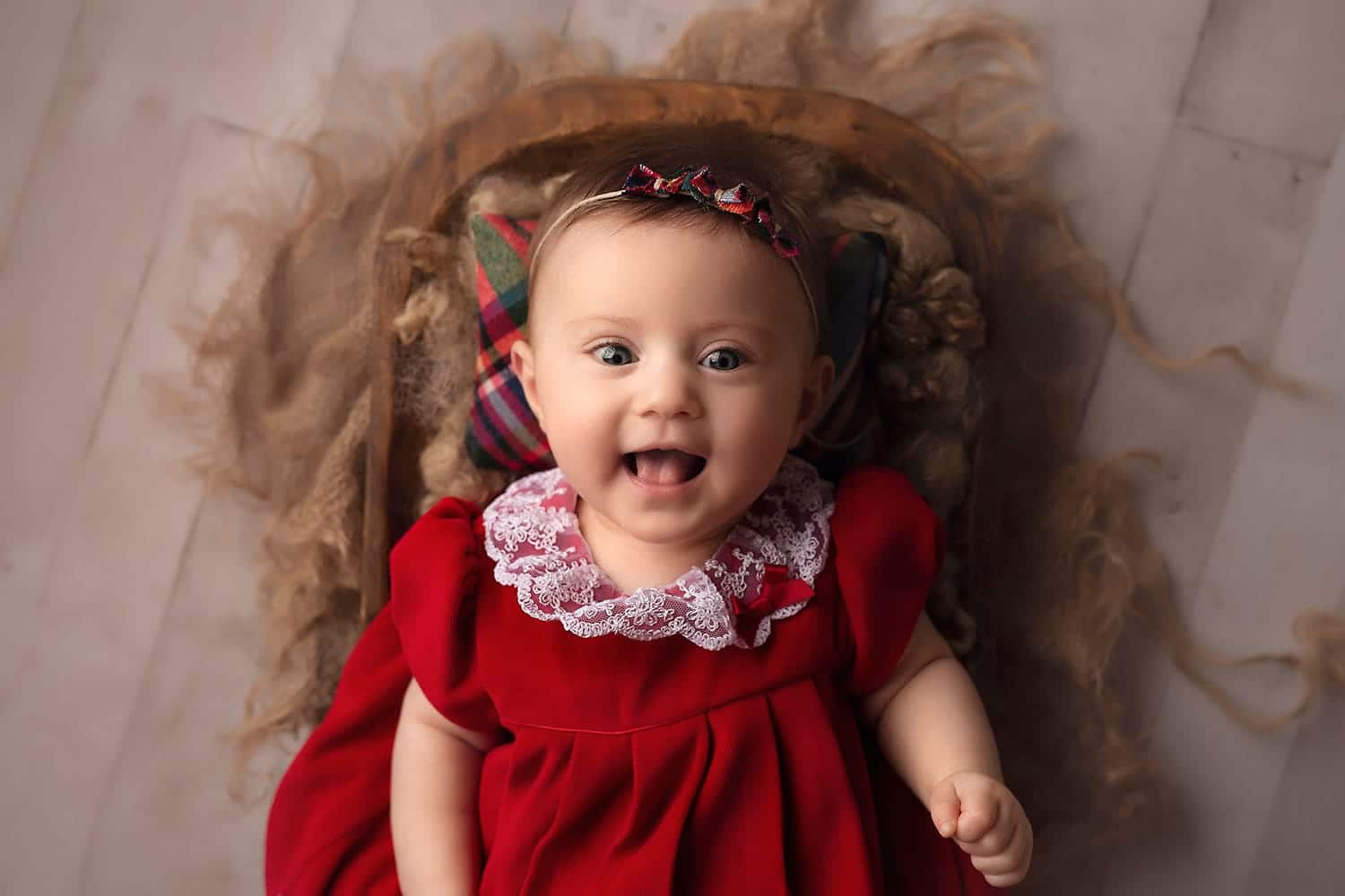 beautiful baby girl in red Christmas dress by Annie Whitaker photography