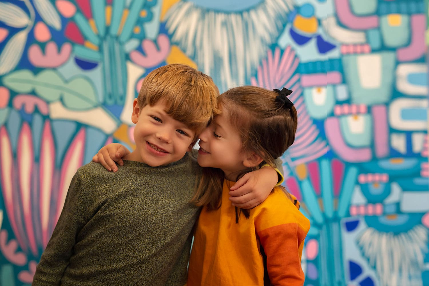 brother and sister at colorful art studio by Annie Whitaker Photography