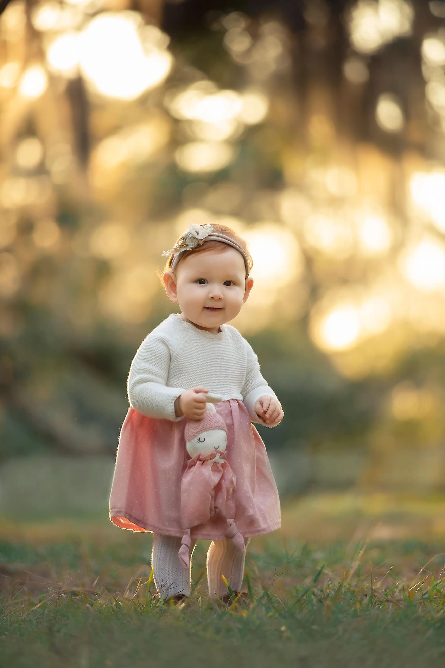 Beautiful one year old girl at sunset holding bunny lovie by Annie Whitaker Photography