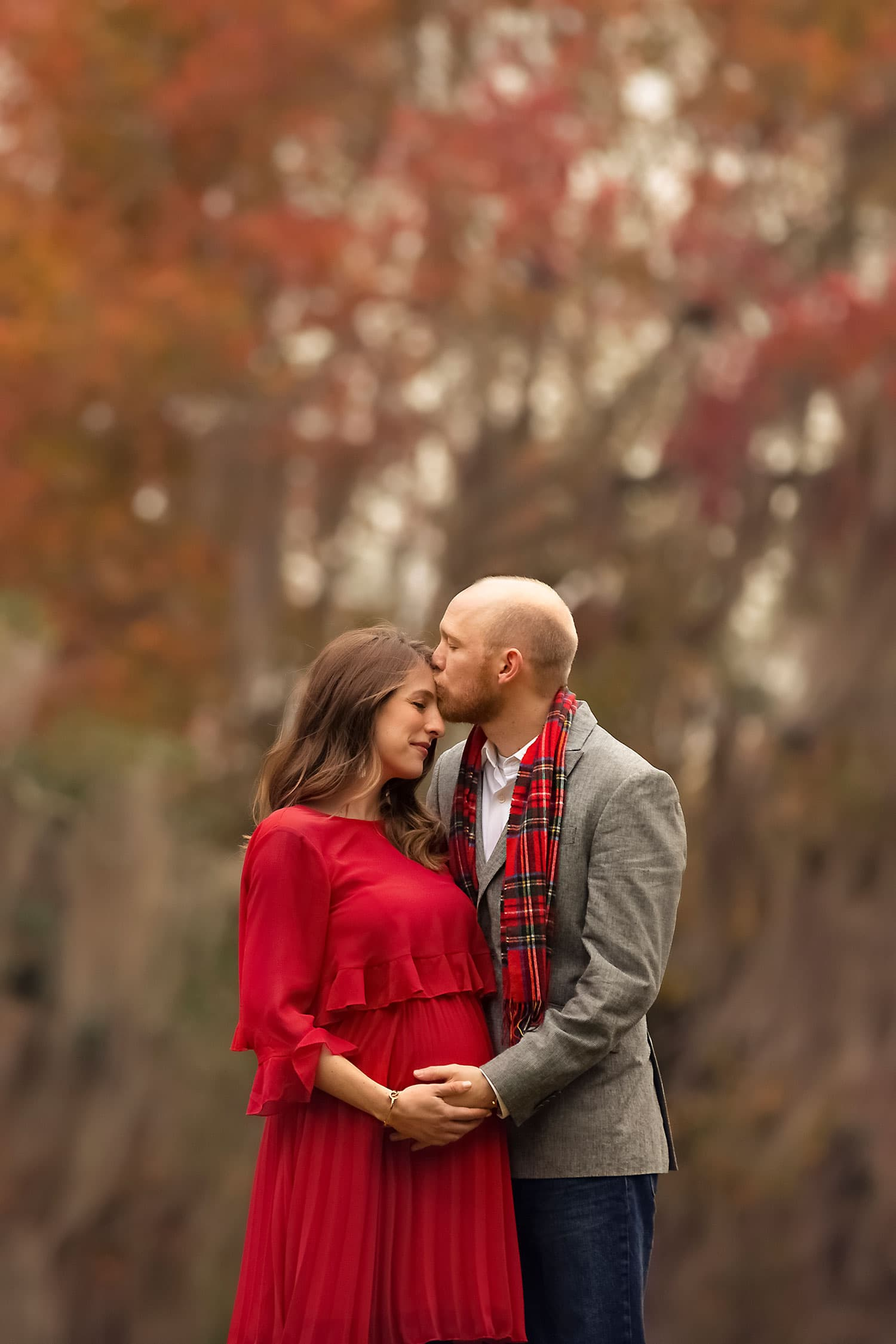 Husband and wife at Christmas maternity session by Annie Whitaker Photography