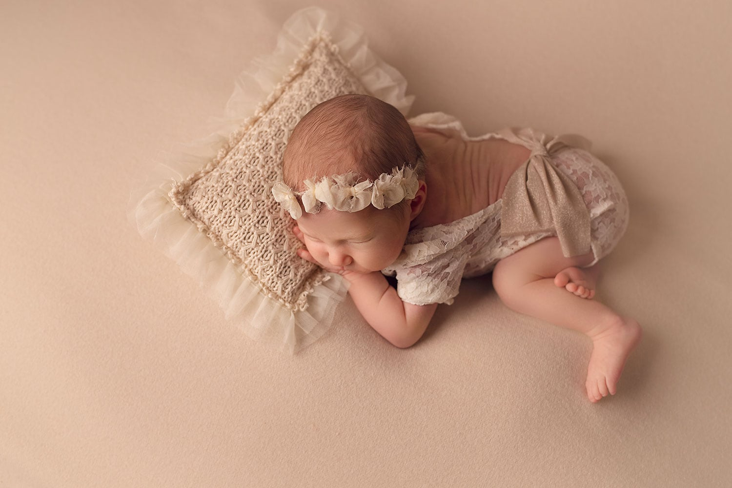 Baby girl in cream outfit