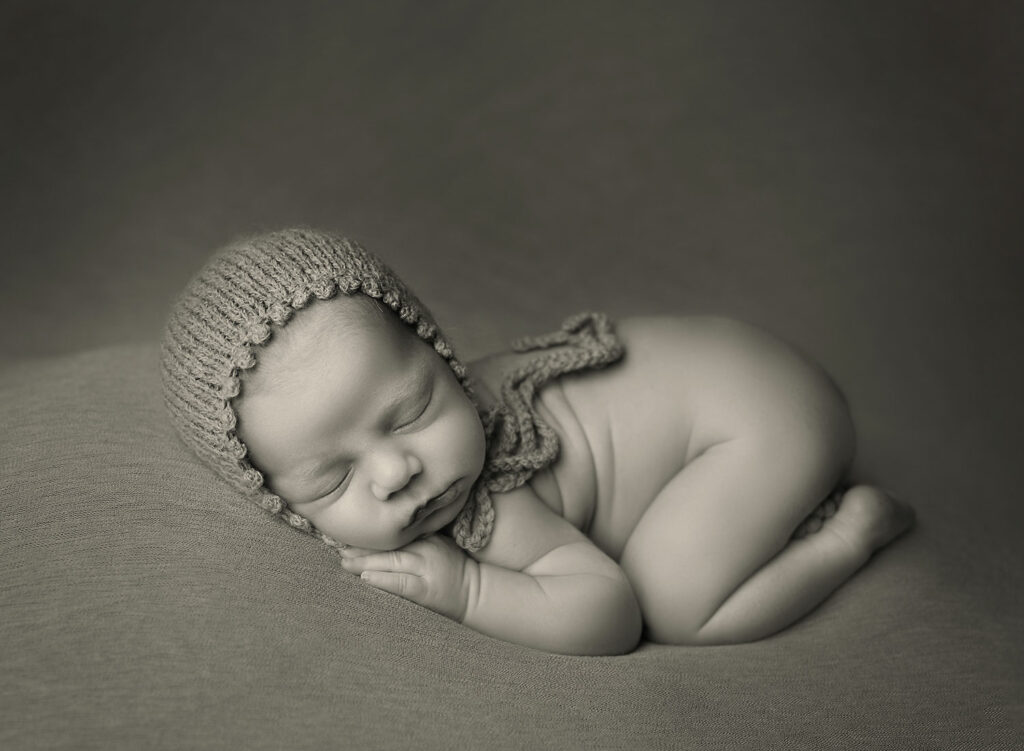 black and white photo of newborn baby