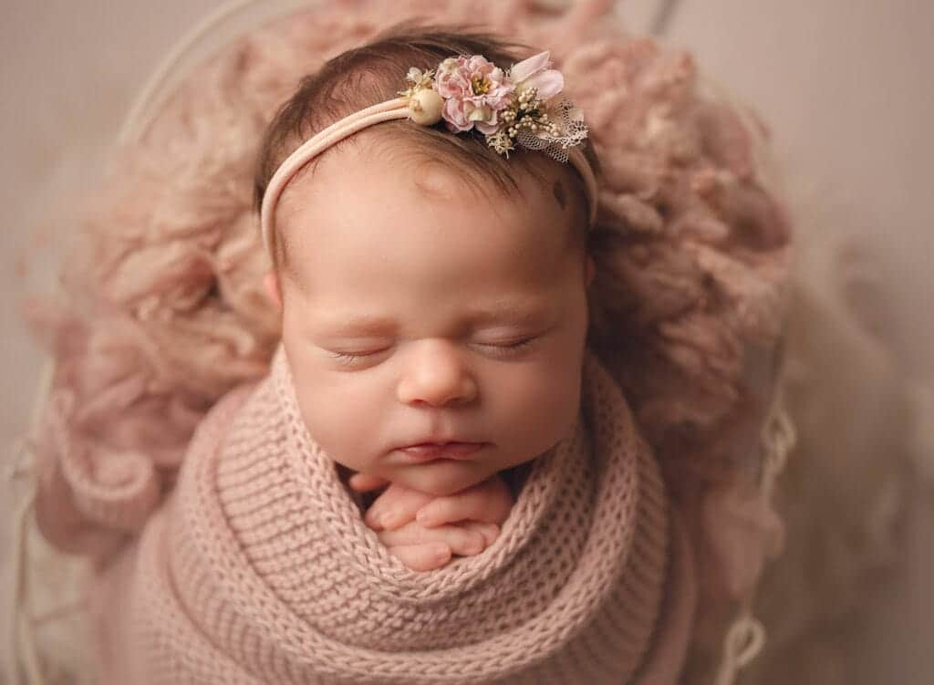 newborn baby wrapped in pink