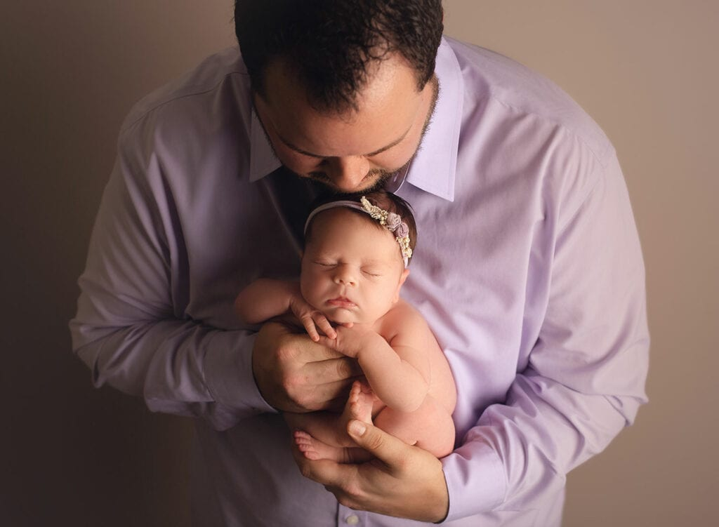 newborn baby girl with dad