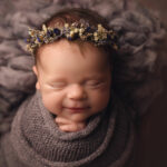 Newborn girl smiling