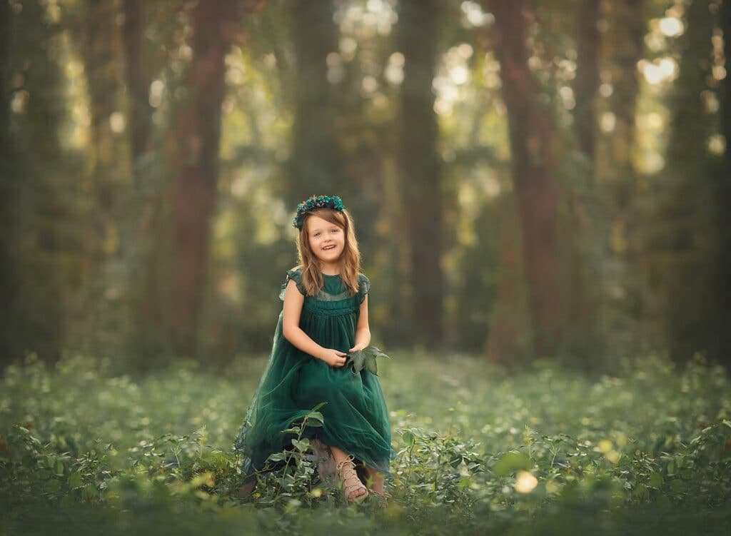 6 year old girl in forest with green dress