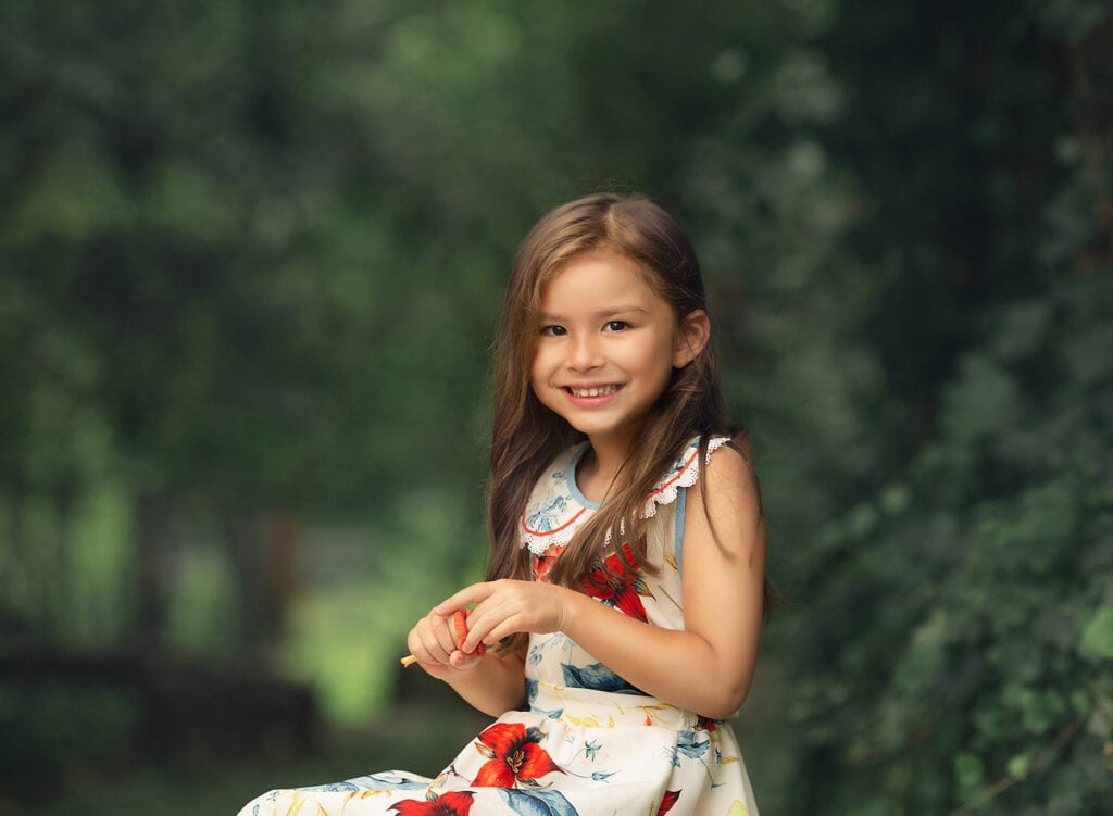 close up photo of 5 year old girl in floral dress