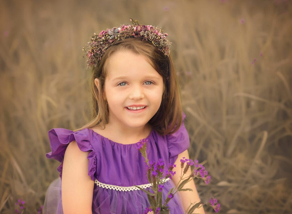stunning photo of 6 year old girl in field of flowers