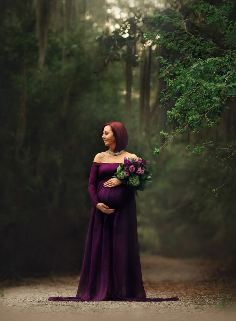 fine art photo of expecting mother holding flowers