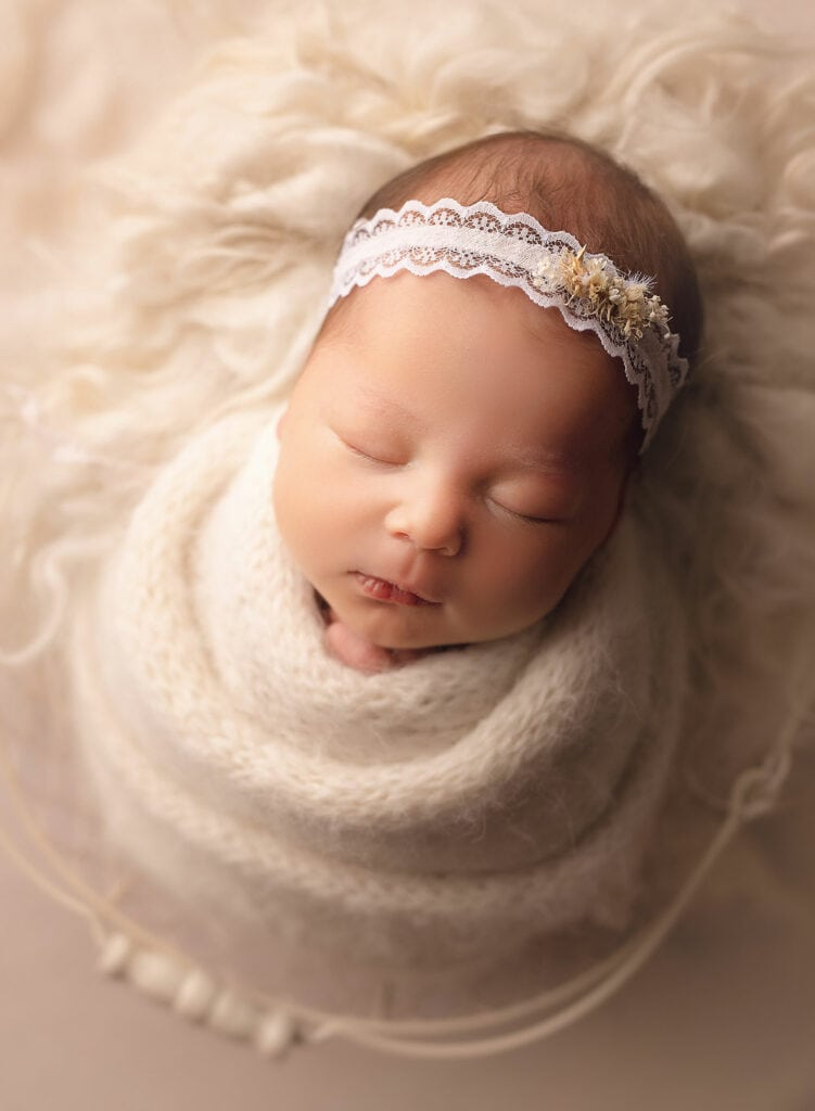 newborn baby in all white