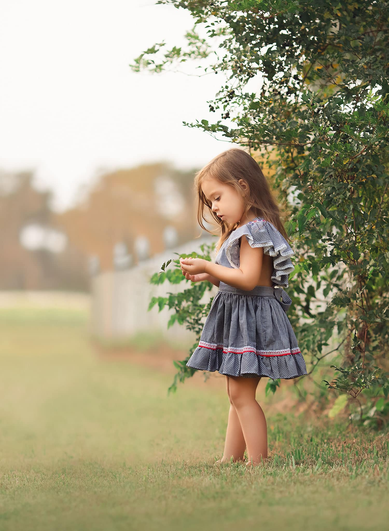 little girl in vintage pinafore