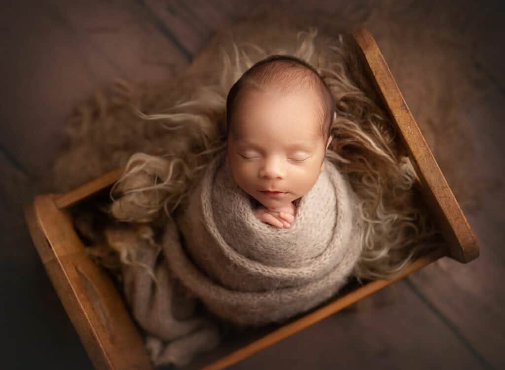 wrapped baby in original photoblocks props bed