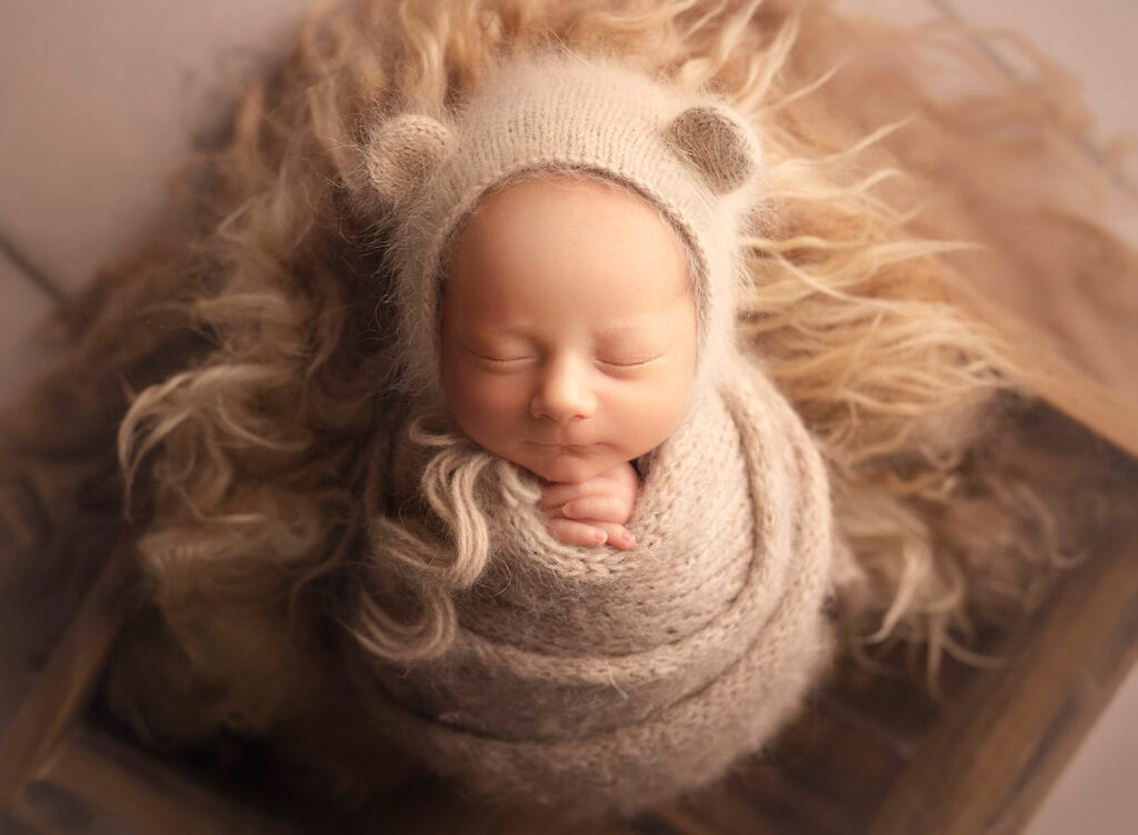 newborn boy in bear bonnet