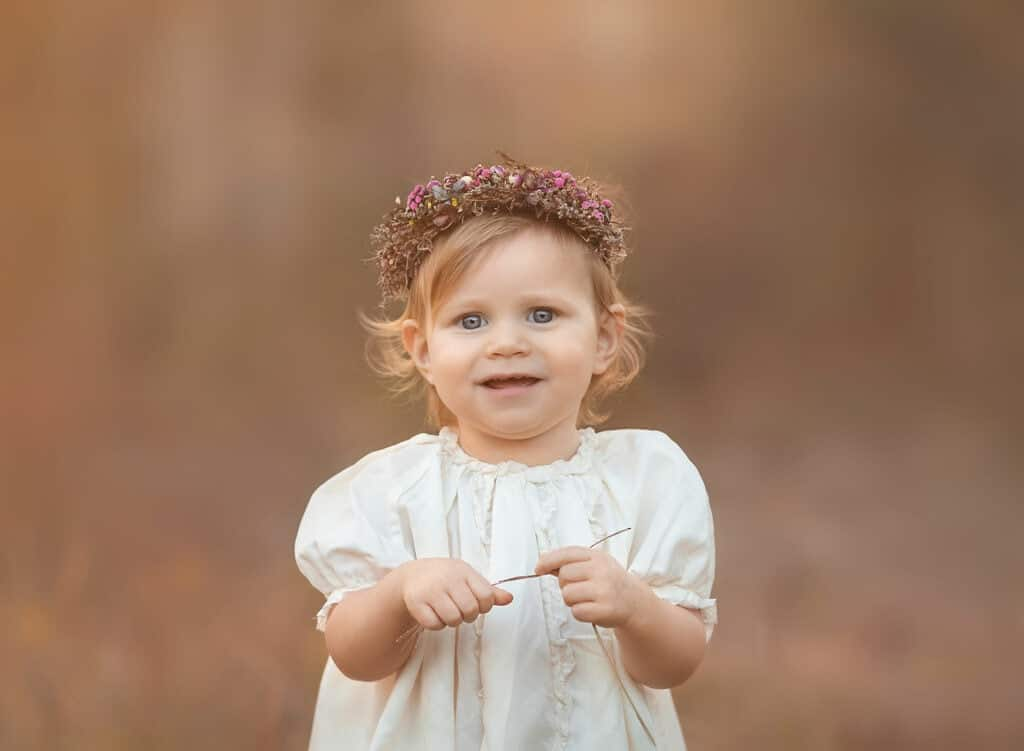 close up of baby girl in flower crown