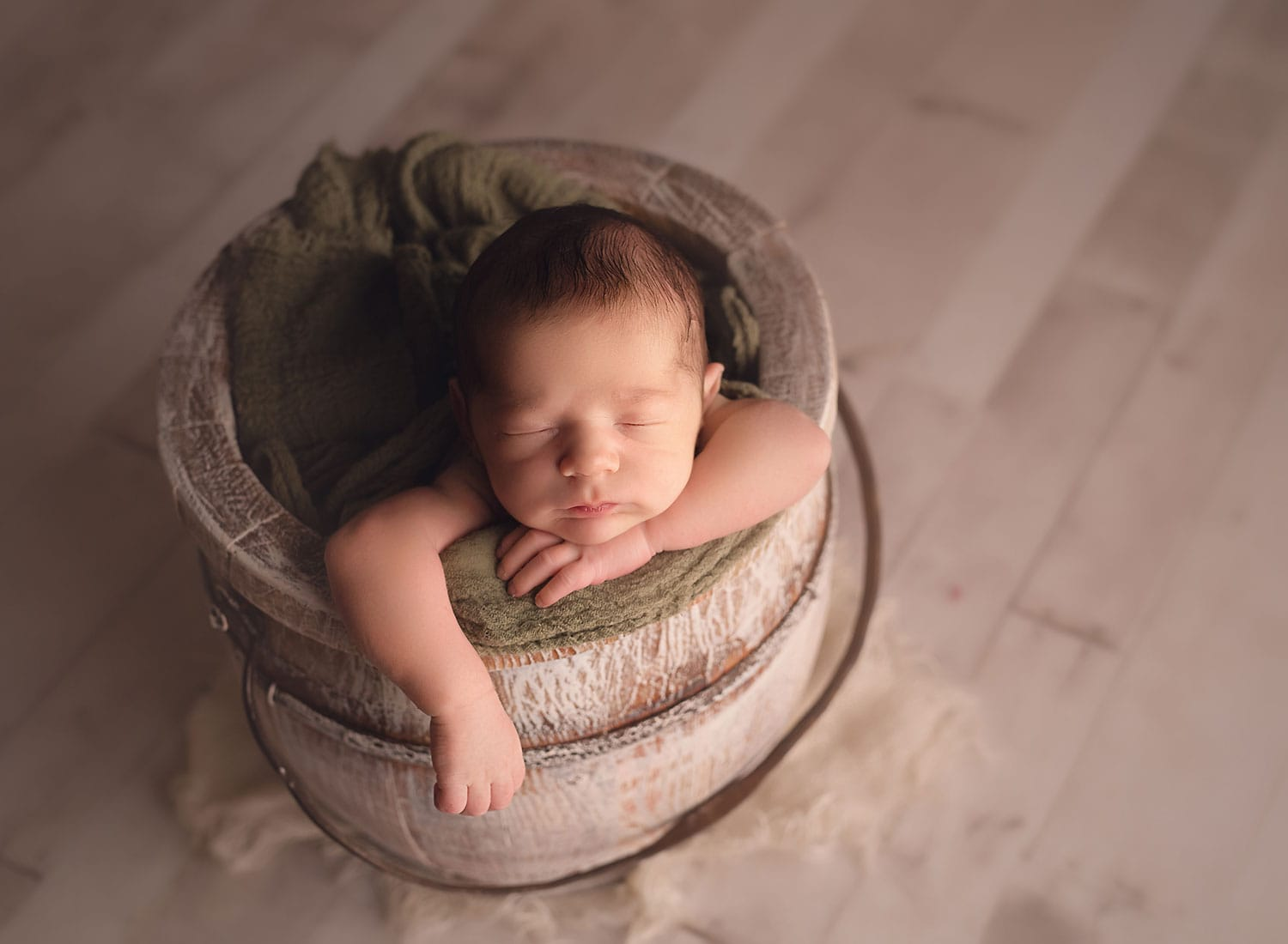 newborn boy in bucket pose