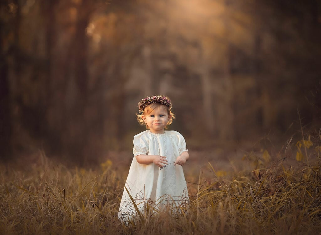 Stunning fine art photo of one year old girl at sunset