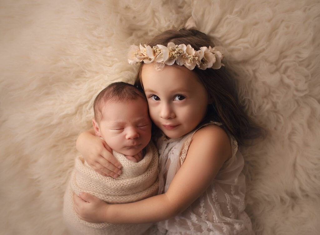 newborn boy with two year old sister