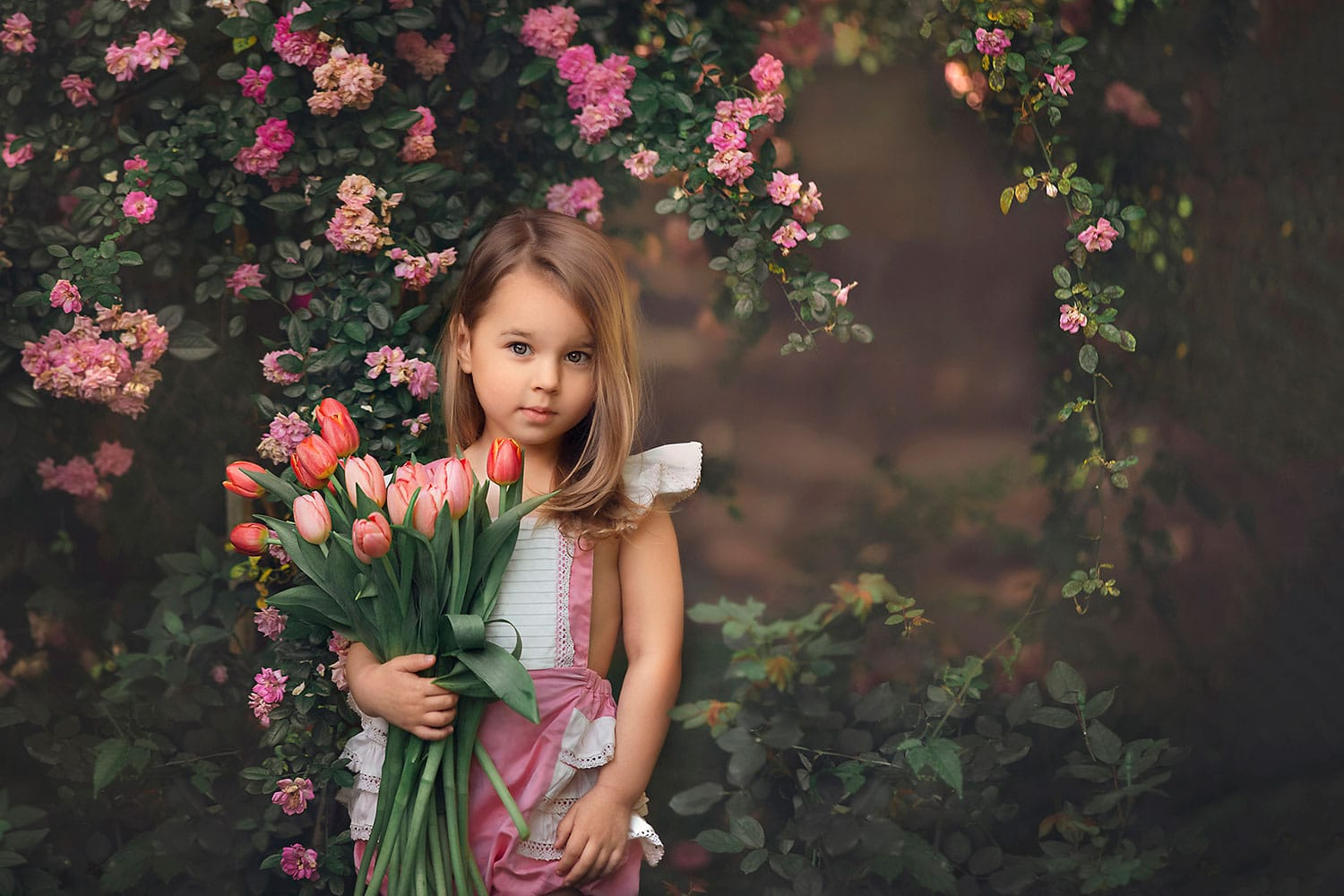 fine art photo of girl with tulips