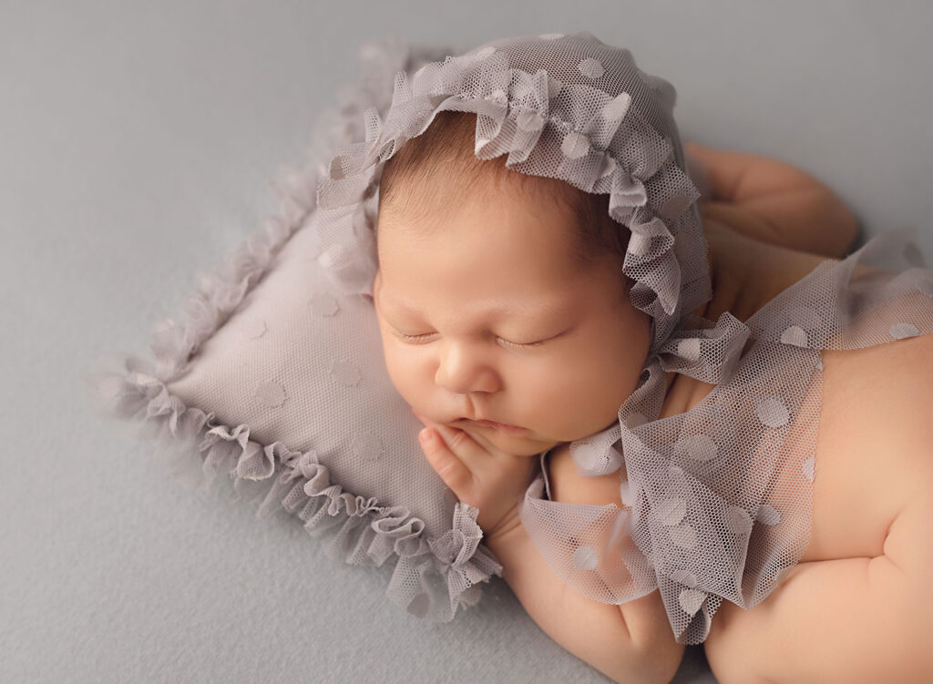 newborn girl on blue
