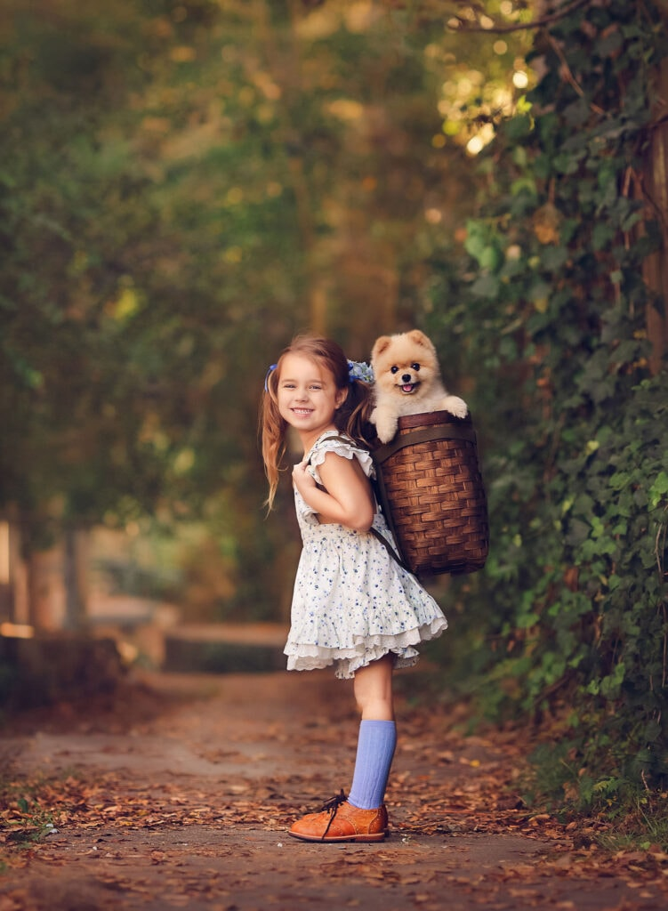 girl with puppy in basket