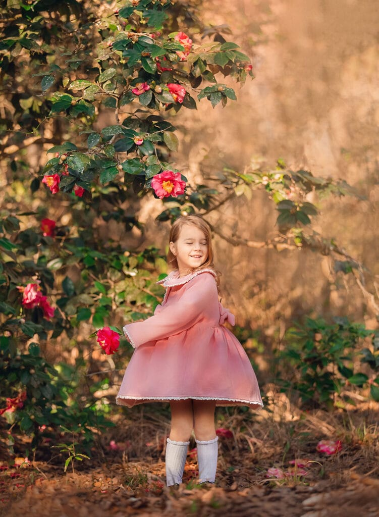 girl twirling in pink coat