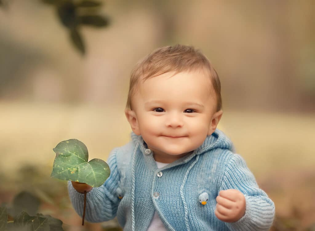 9 month old baby boy in blue sweater