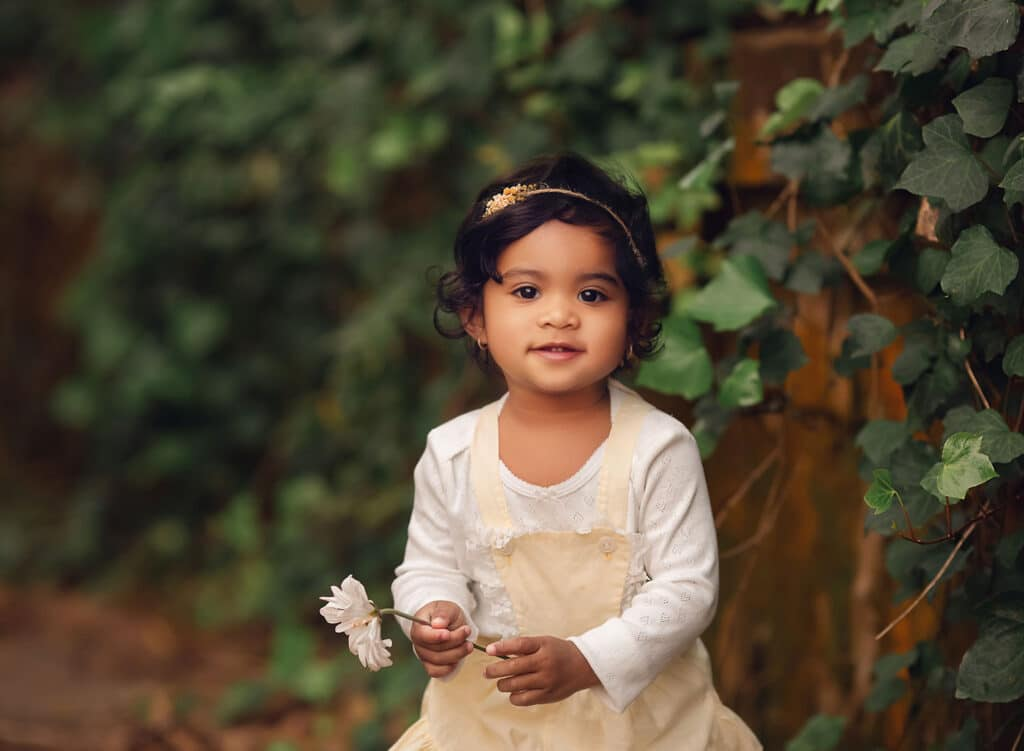 beautiful photo of toddler girl with flower