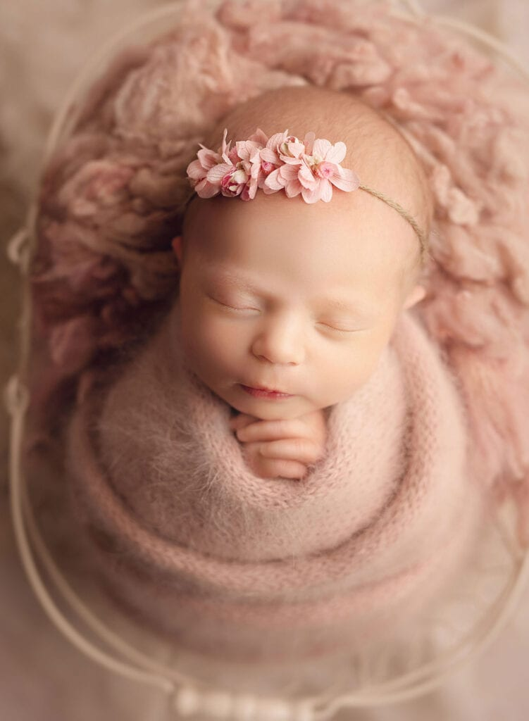 newborn girl in all pink set up