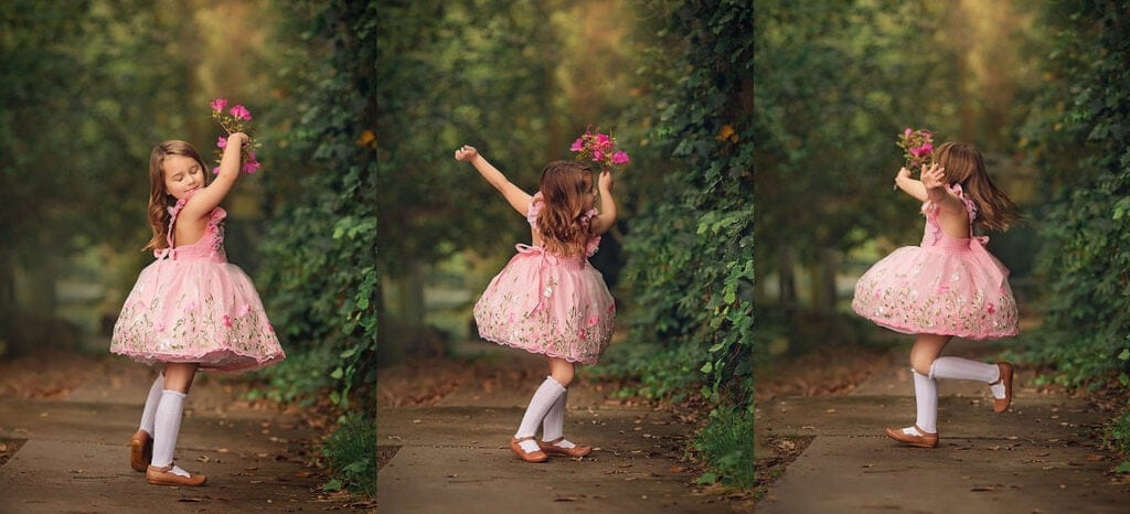 girl twirling in pink dress holding flowers