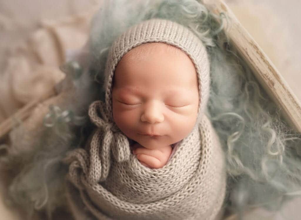 newborn boy on sage fur