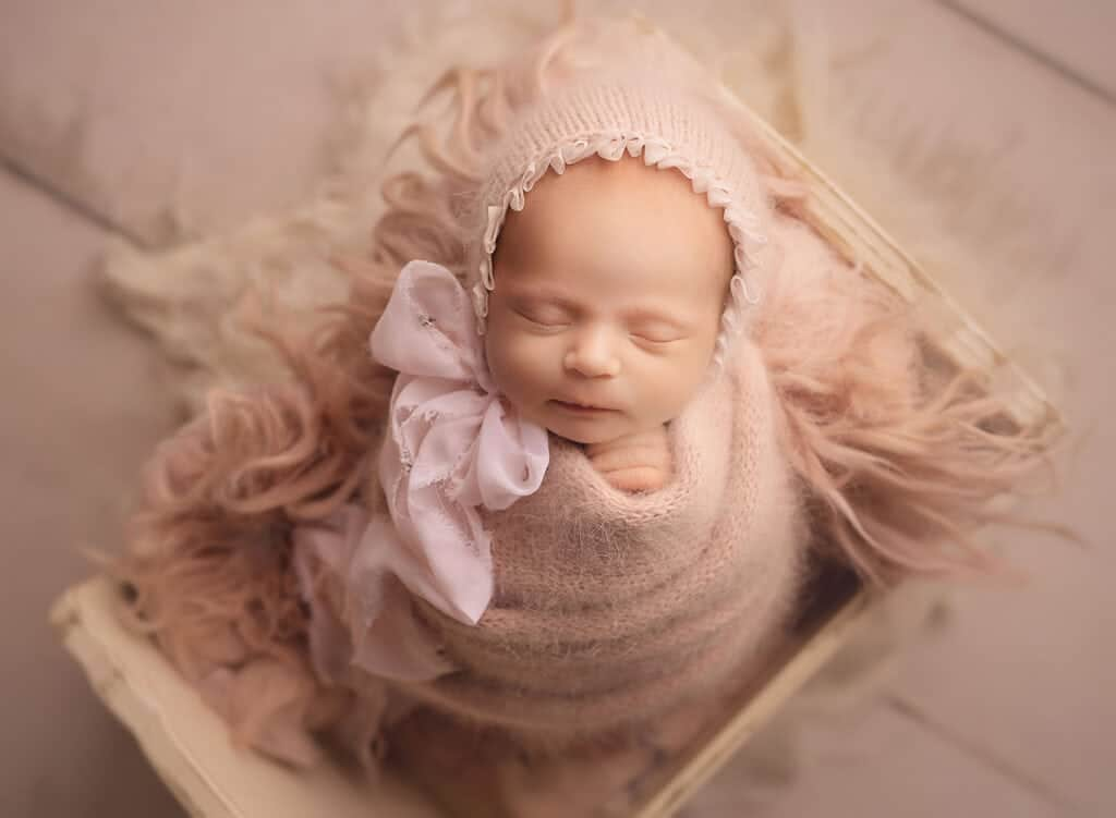 perfectly swaddled newborn girl