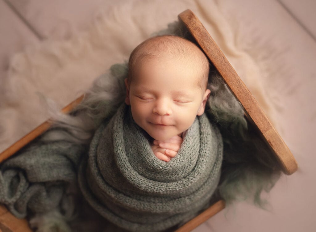 smiling newborn boy
