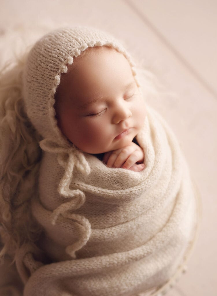 2 month old baby posed like newborn