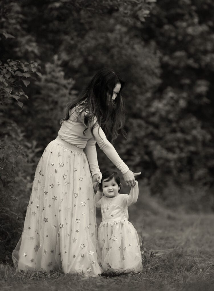mother with daughter holding hands