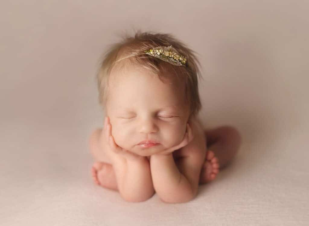 blond haired newborn girl in froggy pose
