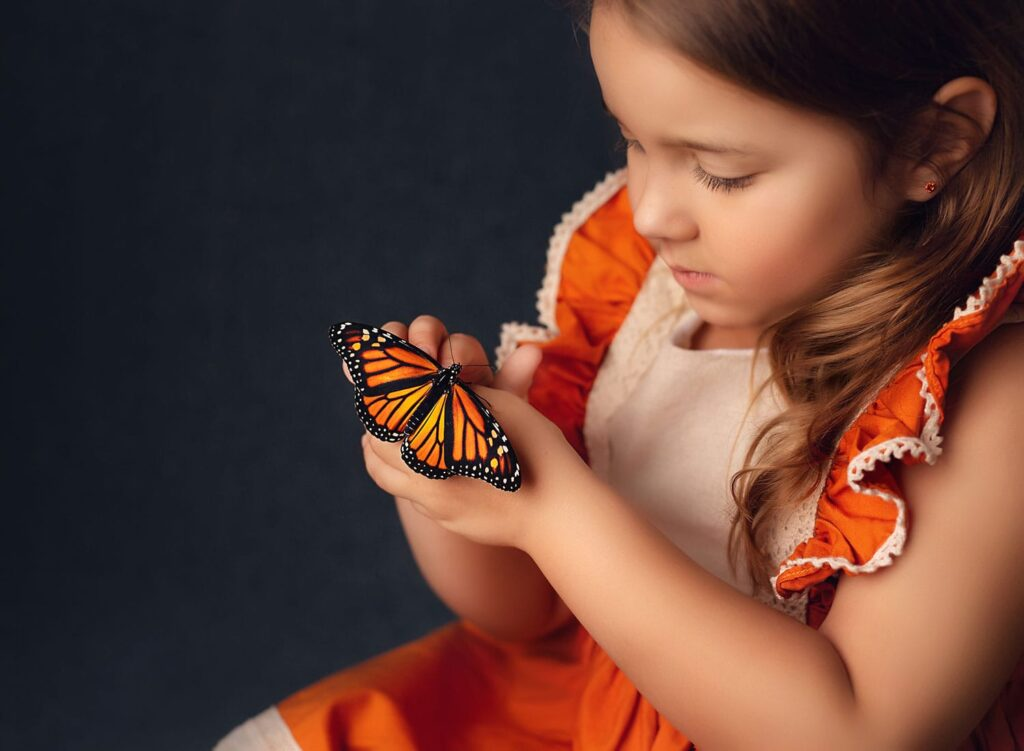 stunning photo of girl with monarch butterfly