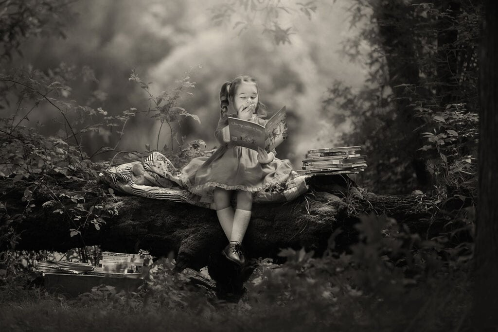 black and white photo of girl reading