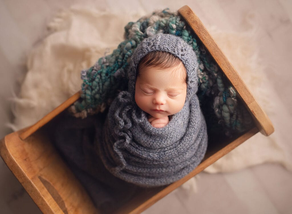 newborn baby in all blue set up