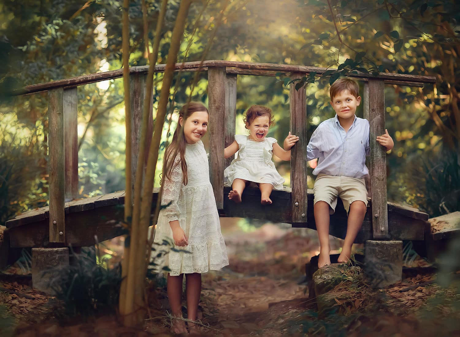 three children on bridge