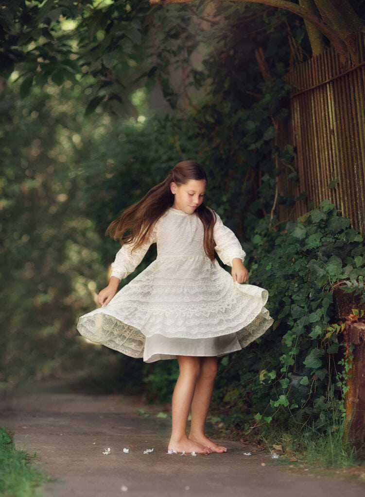 girl spinning in white dress