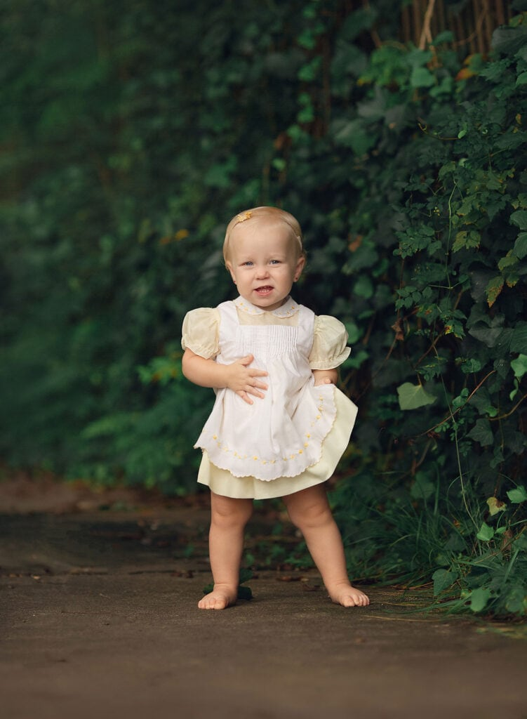 one year old girl in vintage dress