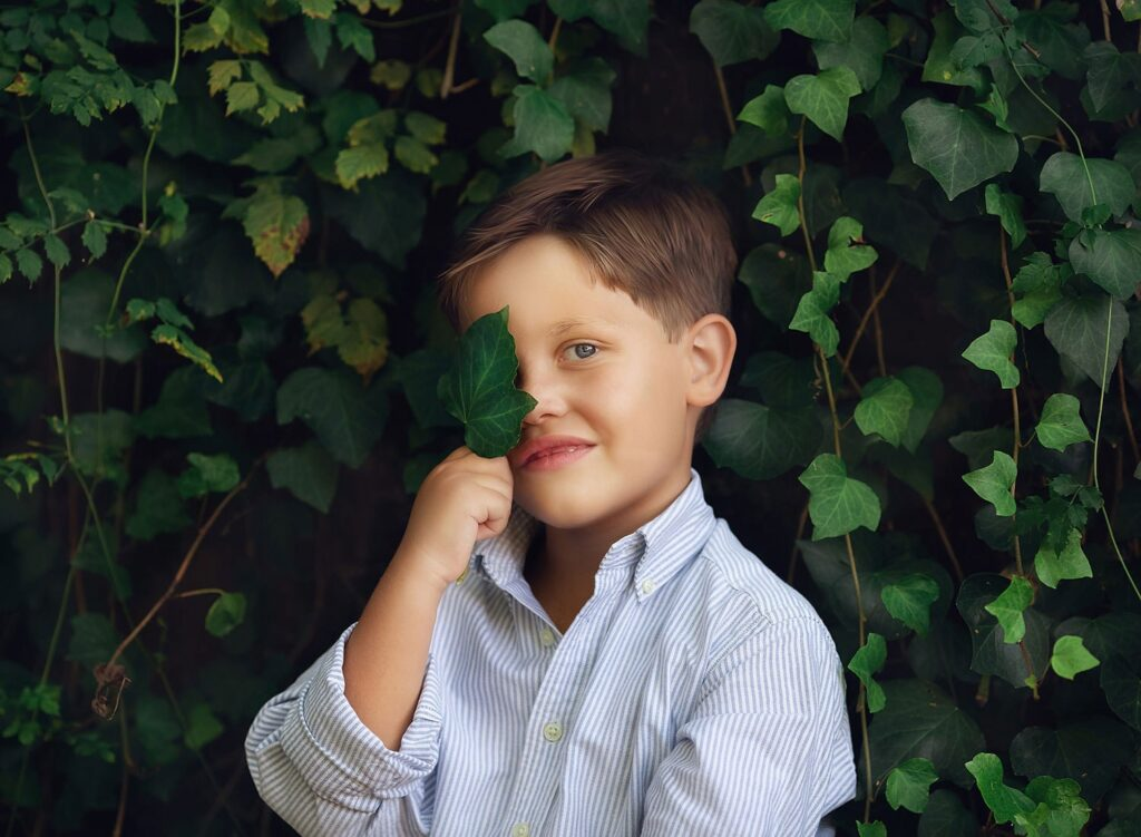 fine art photo of boy with leaf