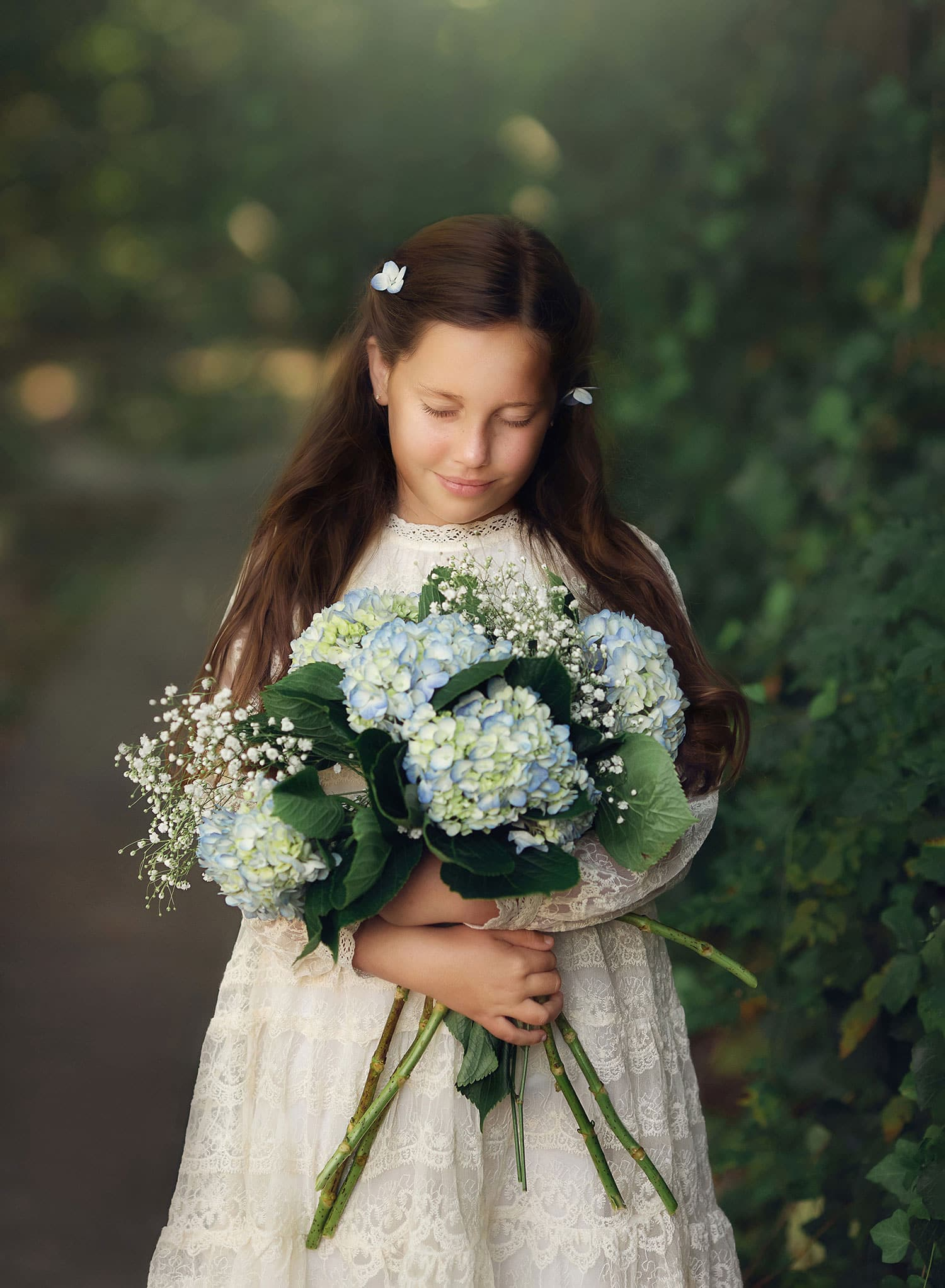 fine art photo of girl with hydrangeas