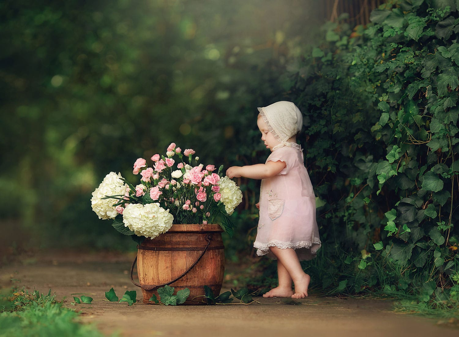 Fine art photo of baby girl with pink flowers