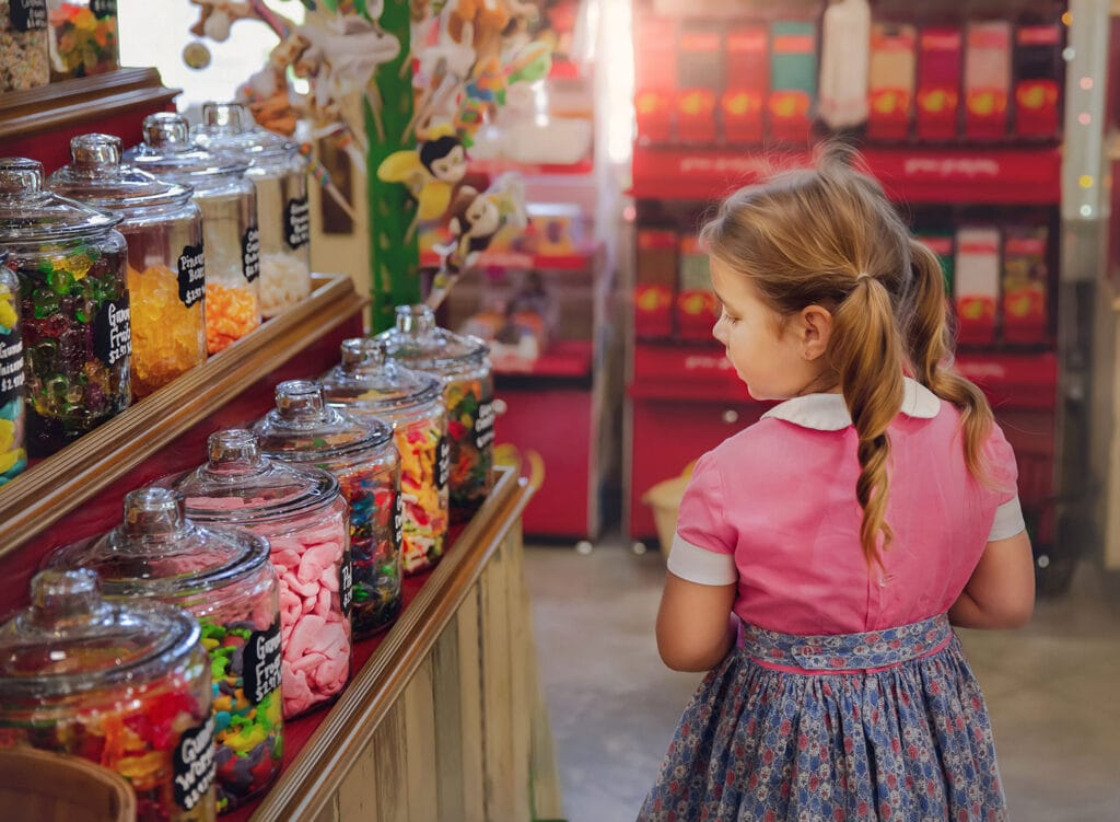 Fine art photo of girl in candy store