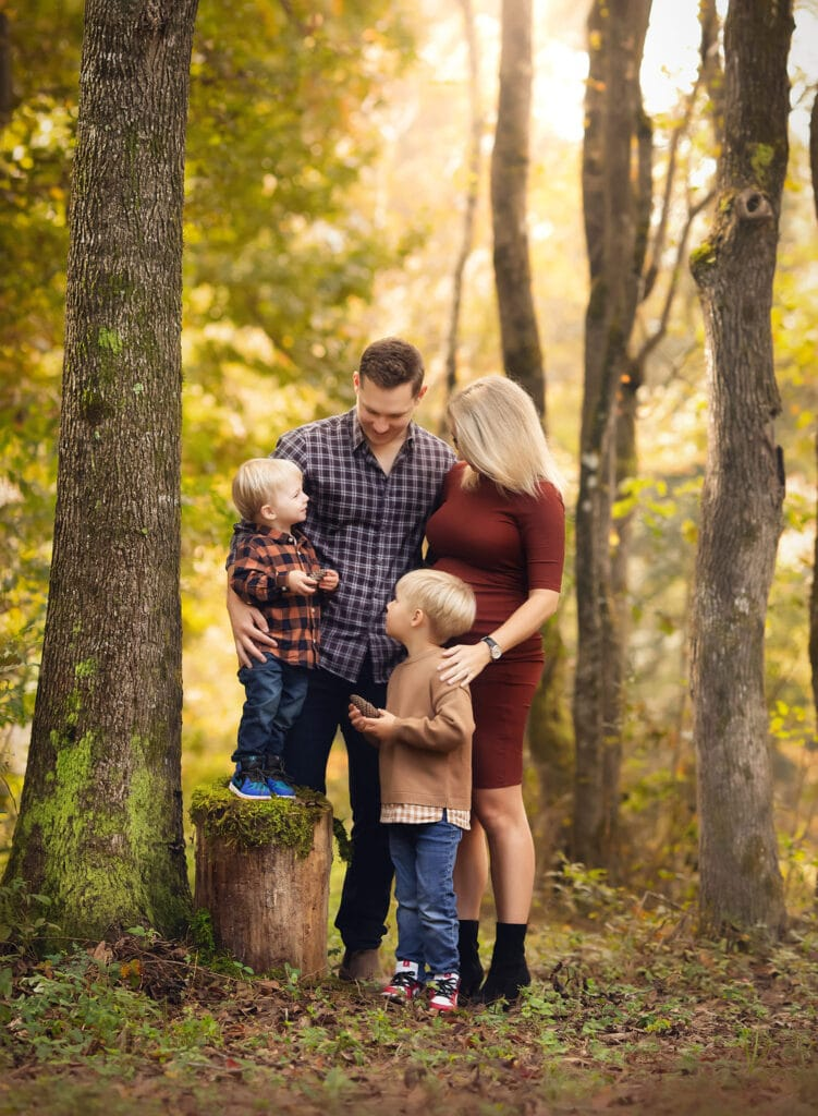 family of four in forest